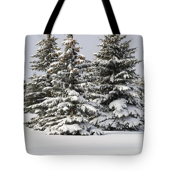 Snow Covered Evergreen Trees Calgary Tote Bag by Michael Interisano