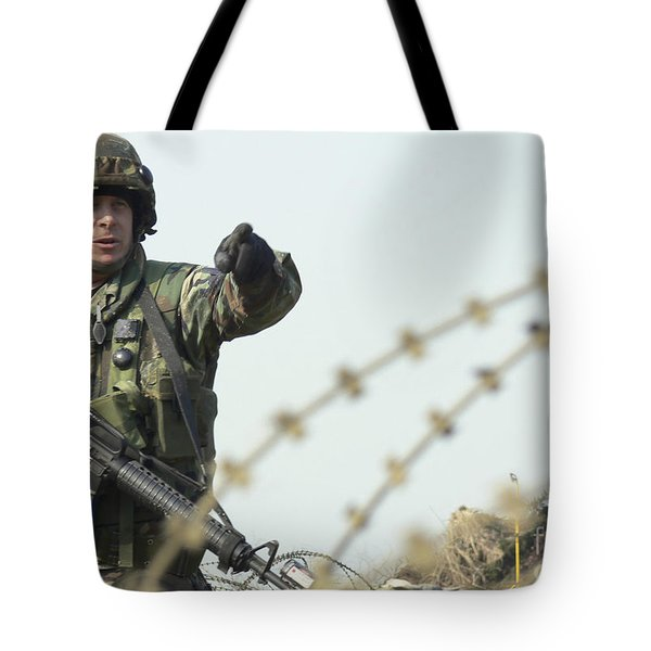 Soldier Calls Out Approaching Locals Tote Bag by Stocktrek Images