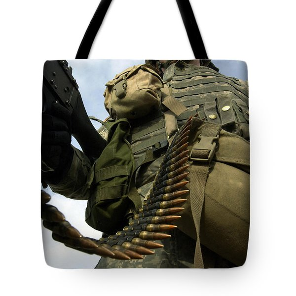 Soldier Mans A Vehicle Mounted 7.62 Mm Tote Bag by Stocktrek Images