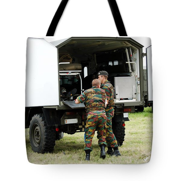 Soldiers Of An Infantry Section Tote Bag by Luc De Jaeger