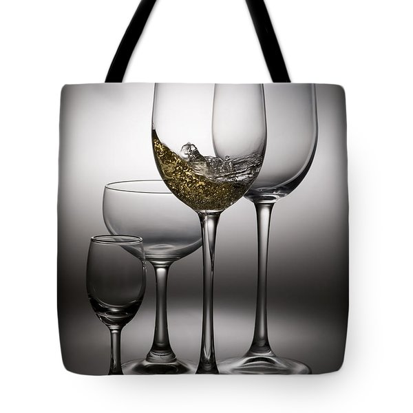 Splashing Wine In Wine Glasses Tote Bag by Setsiri Silapasuwanchai
