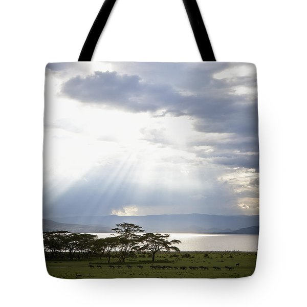 Sunlight Shines Down Through The Clouds Tote Bag by David DuChemin
