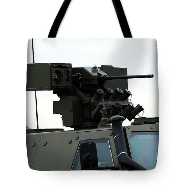 The Gun Mounted On Top Of The Dingo II Tote Bag by Luc De Jaeger