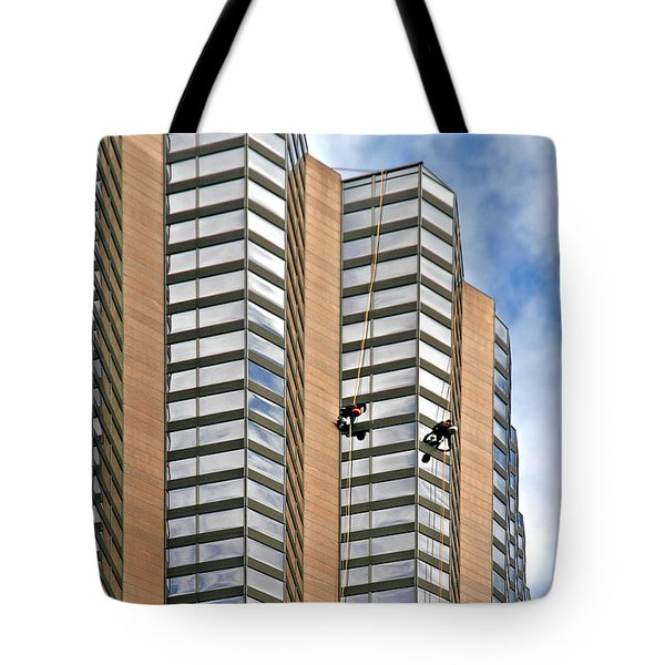 The Loneliness of the Skyscraper Window Cleaner Tote Bag by Christine Till