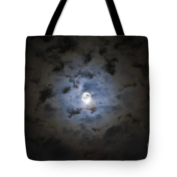The Moon Covered By A Layer Of Clouds Tote Bag by Miguel Claro
