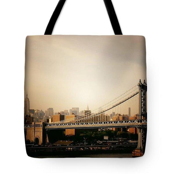The New York City Skyline And Manhattan Bridge At Sunset Tote Bag by Vivienne Gucwa
