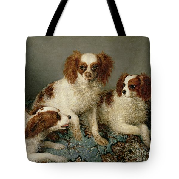 Three Cavalier King Charles Spaniels On A Rug Tote Bag by English School