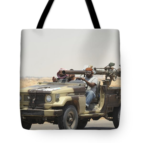 Three Rebel Fighters In A 4x4 Tote Bag by Andrew Chittock