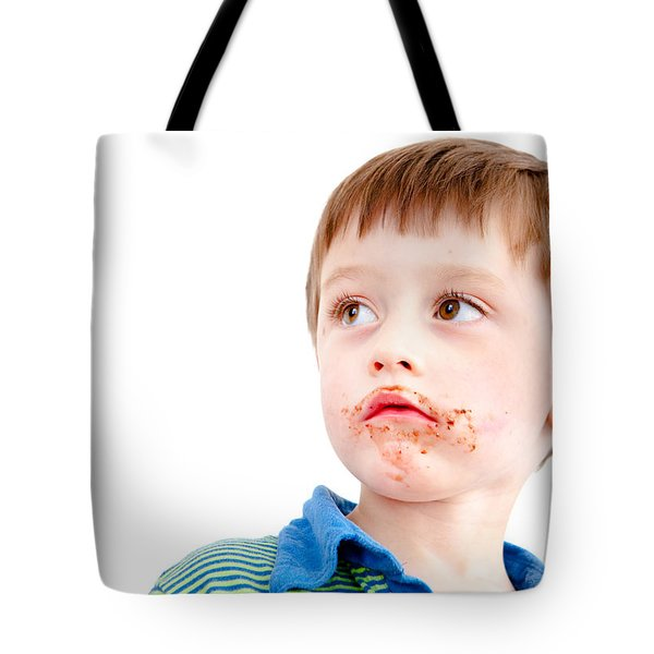 Toddler eating chocolate Tote Bag by Tom Gowanlock