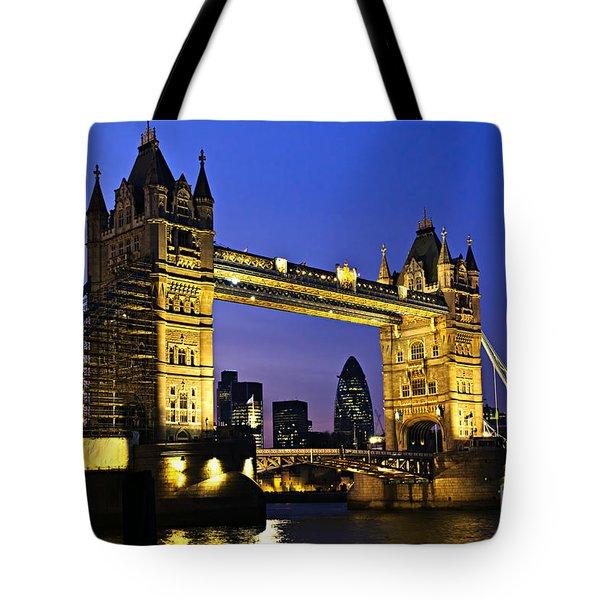 Tower Bridge In London At Night Tote Bag by Elena Elisseeva
