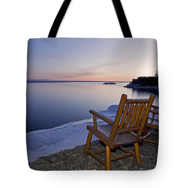 Two Chairs At Waters Edge Looking Out Tote Bag by Susan Dykstra