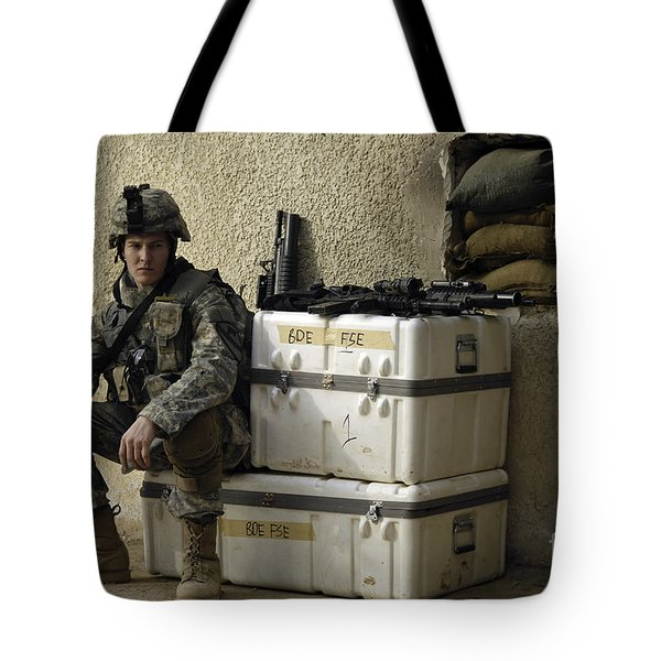 U.s. Army Soldier Relaxing Before Going Tote Bag by Stocktrek Images