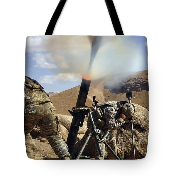 U.s. Army Soldiers Firing A 120mm Tote Bag by Stocktrek Images