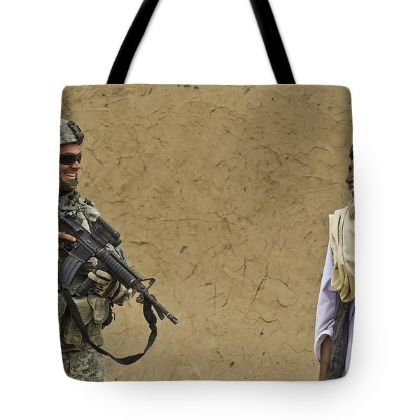 U.s. Army Specialist Talks To An Afghan Tote Bag by Stocktrek Images