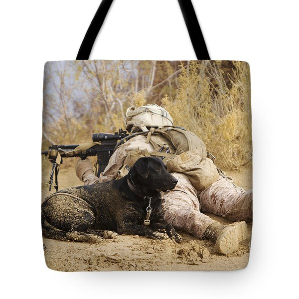 U.s. Marine And A Military Working Dog Tote Bag by Stocktrek Images