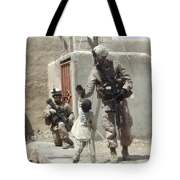 U.s. Marine Gives An Afghan Child Tote Bag by Stocktrek Images