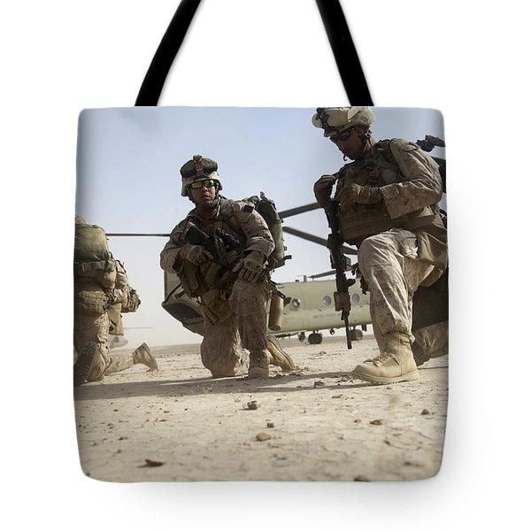 U.s. Marines Unloading Tote Bag by Stocktrek Images