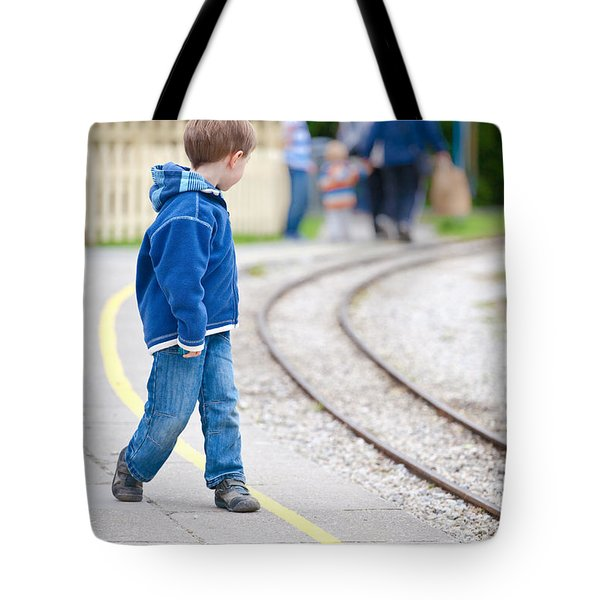 Waiting For Train Tote Bag by Tom Gowanlock