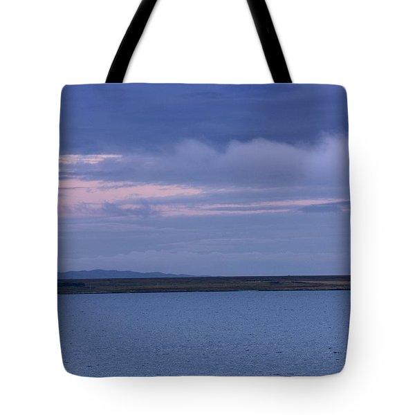 Water And Dark Clouds Tote Bag by John Short