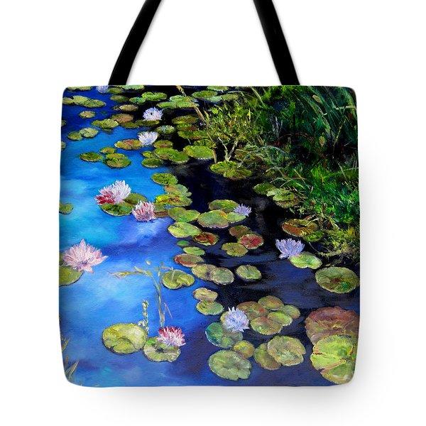 Water Lilies On Blue Tote Bag by Diane Kraudelt