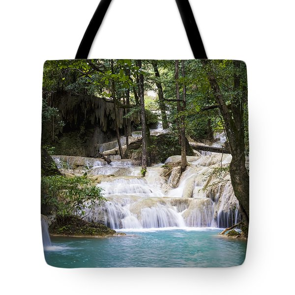 waterfall in deep forest Tote Bag by Setsiri Silapasuwanchai