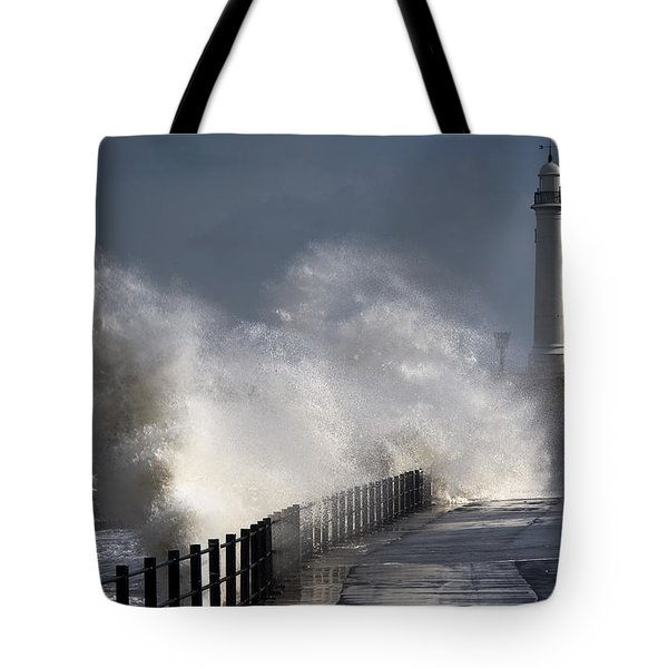 Waves Crashing By Lighthouse At Tote Bag by John Short