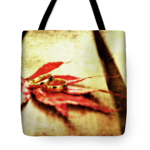 Wedding Rings On Red Tote Bag by Meirion Matthias