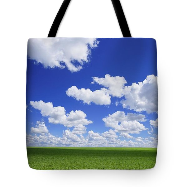 White Clouds In The Sky And Green Meadow Tote Bag by Don Hammond