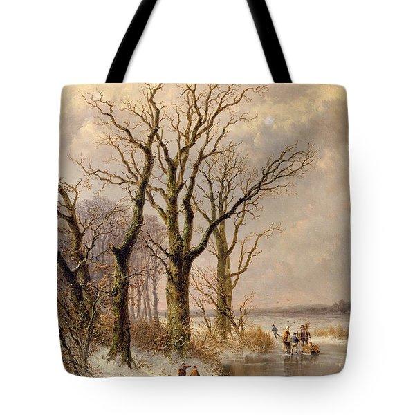 Winter Landscape With Faggot Gatherers Conversing On A Frozen Lake Tote Bag by Josephus Gerardus Hans