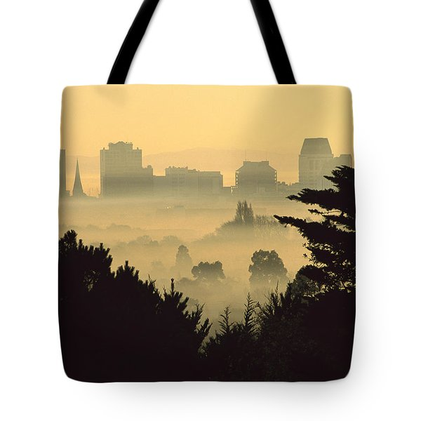 Winter Smog Over The City Tote Bag by Colin Monteath