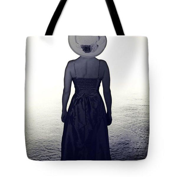 woman at the shore Tote Bag by Joana Kruse