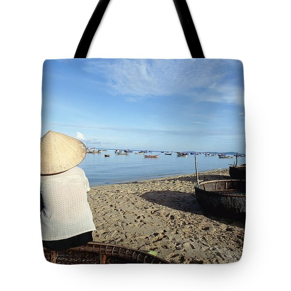 Woman In Conical Hat Sitting On Boat On Tote Bag by Axiom Photographic
