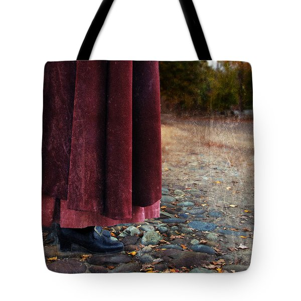 Woman In Vintage Clothing On Cobbled Street Tote Bag by Jill Battaglia
