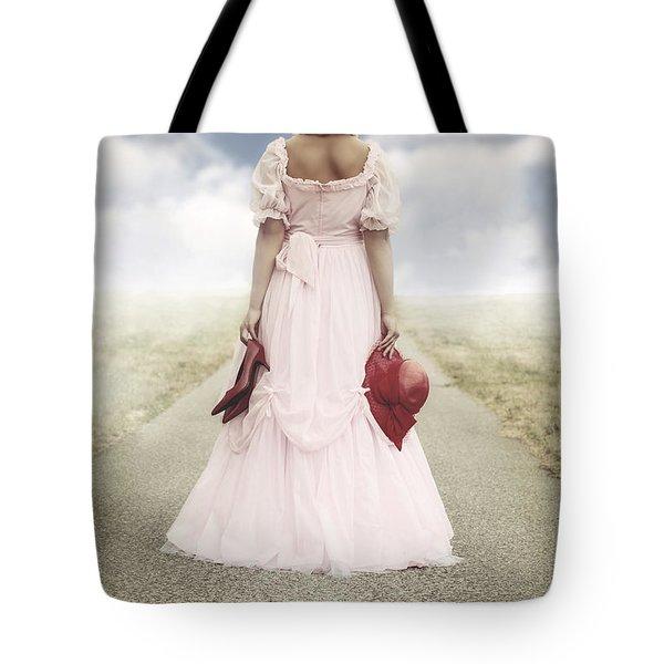 Woman On A Street Tote Bag by Joana Kruse