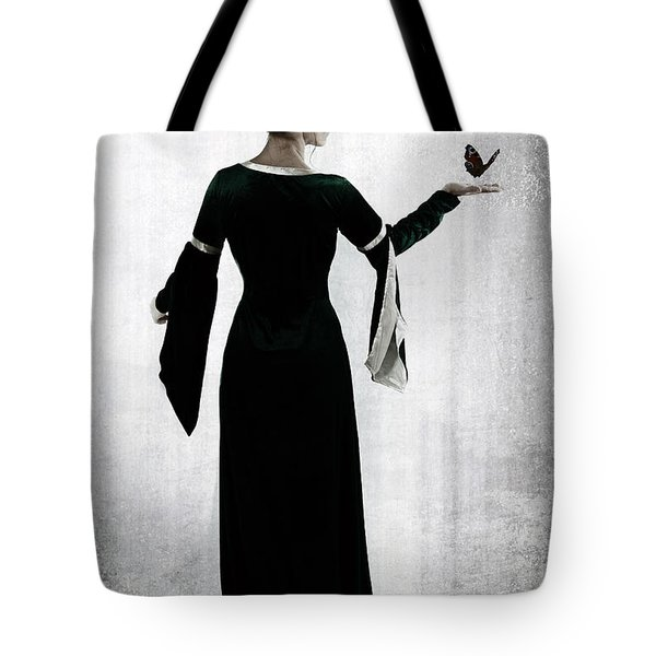 woman with butterfly Tote Bag by Joana Kruse