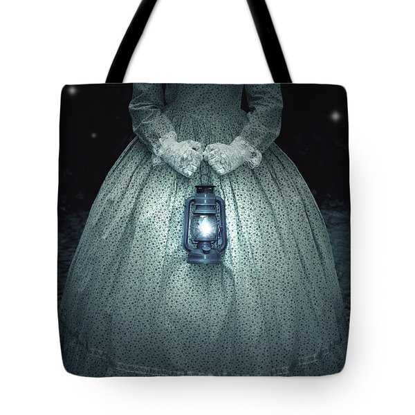 woman with lantern Tote Bag by Joana Kruse