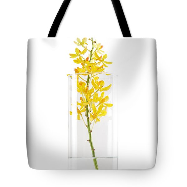 Yellow Orchid In Vase Tote Bag by Atiketta Sangasaeng