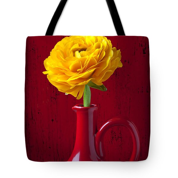 Yellow Ranunculus In Red Pitcher Tote Bag by Garry Gay