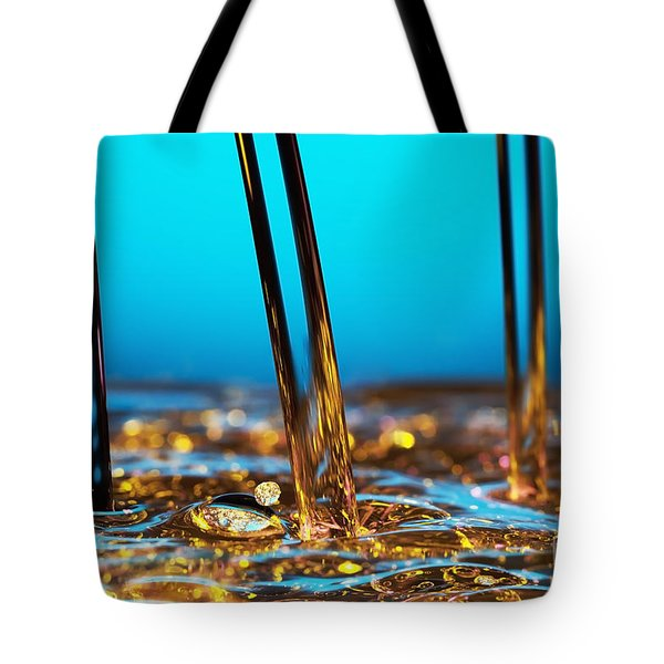 water and oil Tote Bag by Setsiri Silapasuwanchai