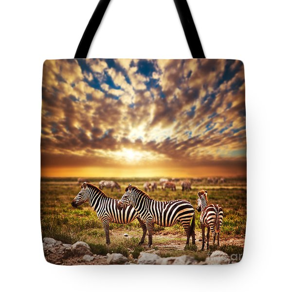 Zebras Herd On African Savanna At Sunset. Tote Bag by Michal Bednarek
