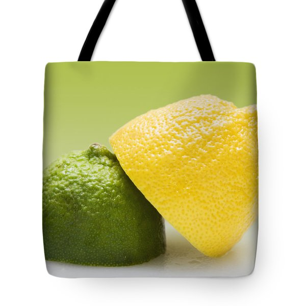 12 Organic Lemon And 12 Lime Tote Bag by Marlene Ford