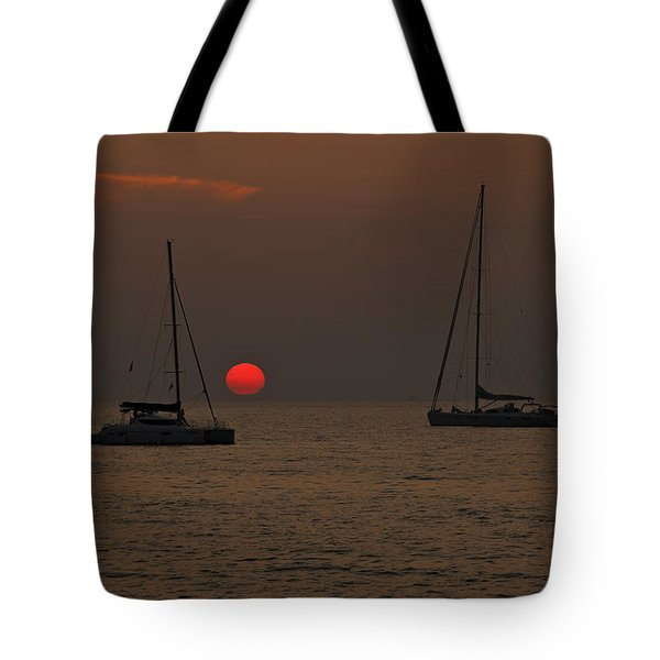 boats in the sunset Tote Bag by Joana Kruse