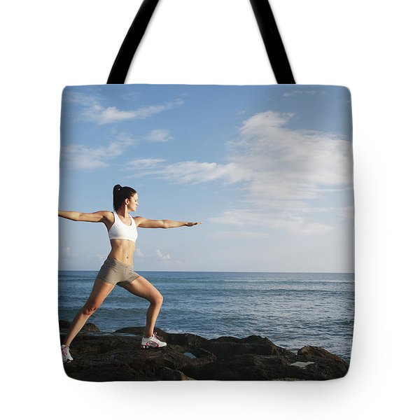 Female doing Yoga Tote Bag by Brandon Tabiolo - Printscapes