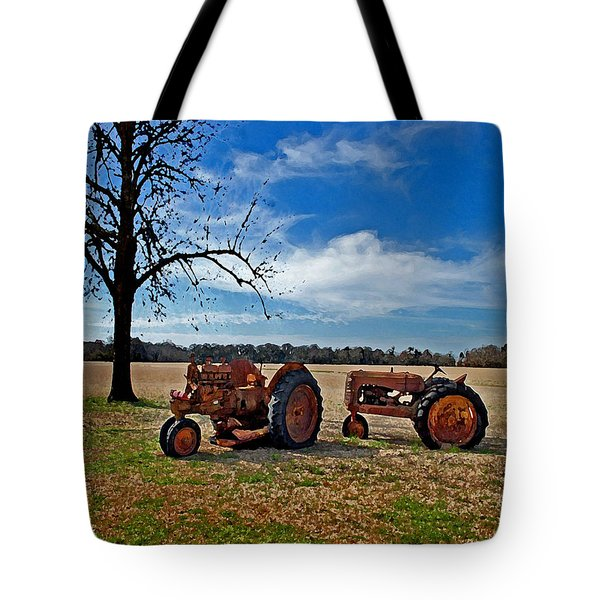 2 Old Tractors And The Tree Tote Bag by Michael Thomas