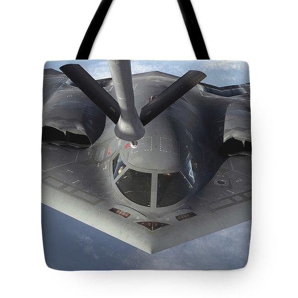 A B-2 Spirit Bomber Prepares To Refuel Tote Bag by Stocktrek Images