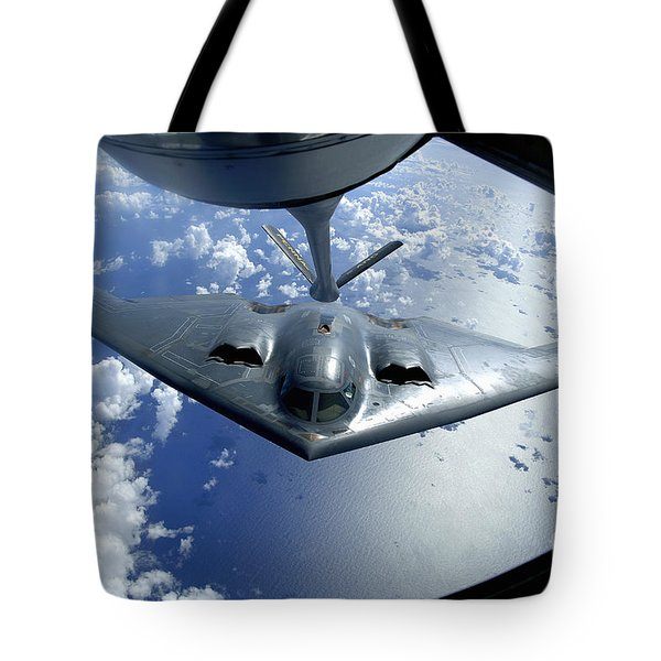 A B-2 Spirit Moves Into Position Tote Bag by Stocktrek Images