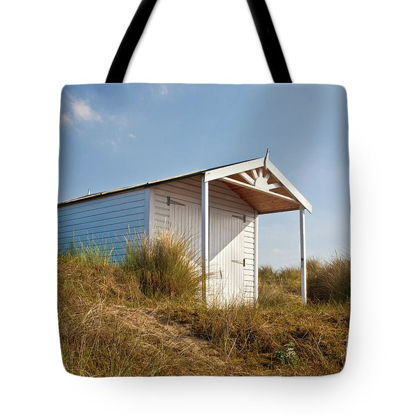 A Beach hut in the Marram Grass at Old Hunstanton North Norfolk Tote Bag by John Edwards