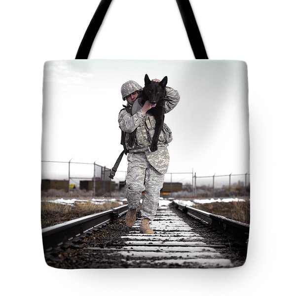 A Military Dog Handler Uses An Tote Bag by Stocktrek Images