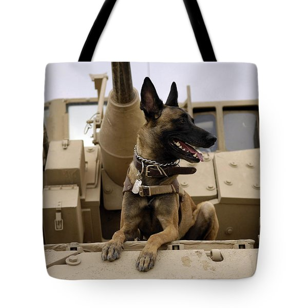 A Military Working Dog Sits On A U.s Tote Bag by Stocktrek Images