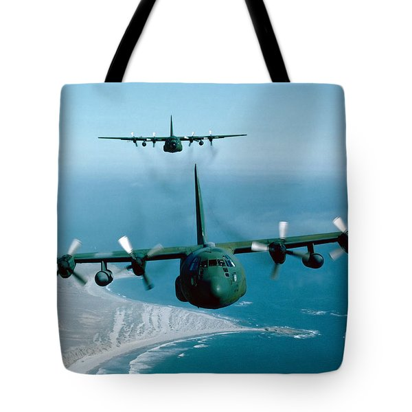 A Pair Of C-130 Hercules In Flight Tote Bag by Stocktrek Images